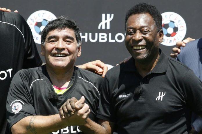 Diego Maradona et Pelé réunis lors d'une campagne publicitaire à Paris, le 9 juin 2016 afp.com - PATRICK KOVARIK