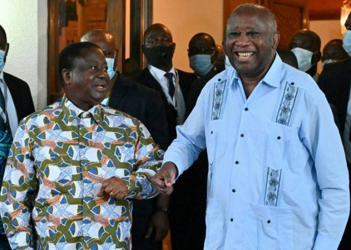 Les deux anciens présidents ivoiriens Laurent Gbagbo (d) et Henri Konan Bédié, le 10 juillet 2021 à Daoukro afp.com - Issouf SANOGO
